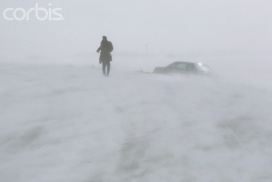 Man Walking Through North Dakota Blizzard