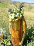 Golf Bag Memorial with flowers and old clubs